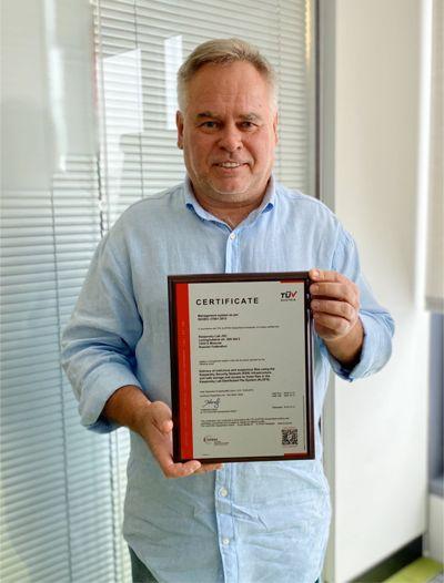 Eugene Kaspersky holding the ISO 27001