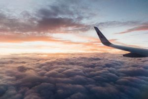 white-airliner-wing-on-top-of-sea-clouds-2007401 3
