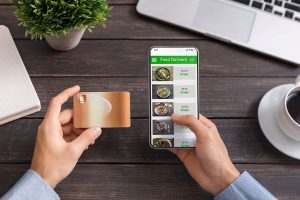 Man-using-mobile-ordering-and-food-delivery-app 3
