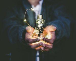 business ideas man holding incandescent bulb
