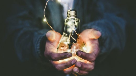 business ideas man holding incandescent bulb