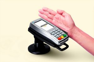 payment gateway person holding black and gray desk calculator