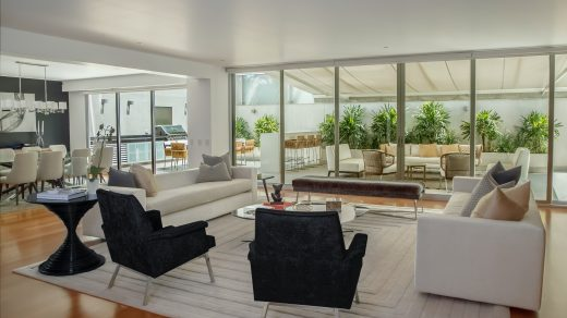 house designs two black suede armchairs during daytime