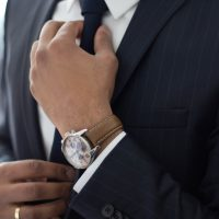 employment attorney man wearing watch with black suit