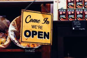 start a business yellow and black come in we're open sign