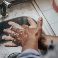 disinfection person in white shirt washing hands