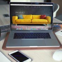 ecommerce marketing turned on MacBook Pro beside gray mug