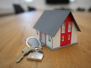 online business directory white and red wooden house miniature on brown table