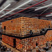 warehouse people in a building with brown cardboard boxes