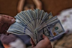 financial tips 100 US dollar banknotes