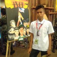 Arjen-poses-beside-his-painting-Pagbangon