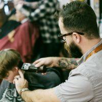 salon marketing ideas man shaving the boy's hair