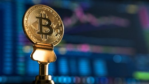 trading bitcoin online selective focus photo of Bitcoin near monitor