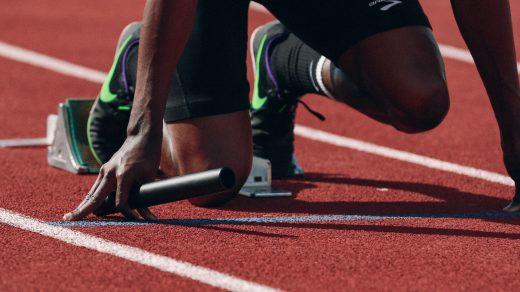 athletes man on running field