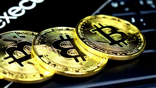 bitcoin three round gold-colored bitcoins