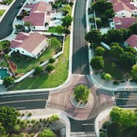 investing in real estate white-and-red houses