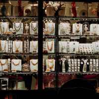 jewelry business brown wooden shelf with assorted items