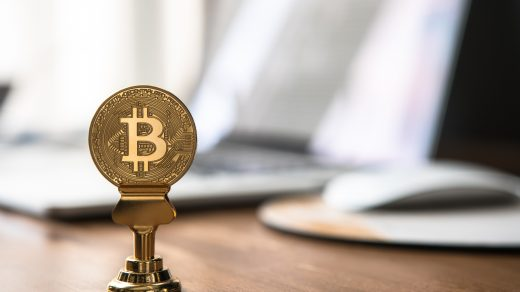 bitcoin round gold-colored bitcoin on table