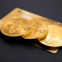 bitcoin three round gold-colored Bitcoin tokens