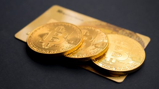 bitcoin three round gold-colored Bitcoin tokens