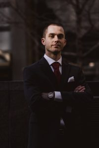 white collar crime man wearing black notched lapel suit jacket in focus photography