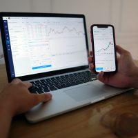 forex broker macbook pro on brown wooden table