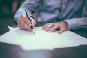 resume man writing on paper