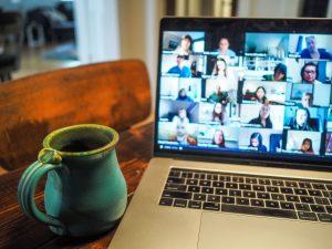 virtual meetings macbook pro displaying group of people