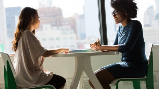 Job Interview two women sitting beside table and talking