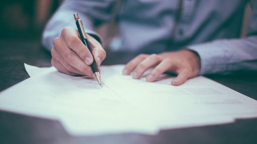 surety bonds man writing on paper