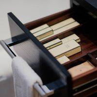 Drawer Slides Installation boxes inside black wooden drawer