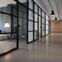 business office space hallway between glass-panel doors
