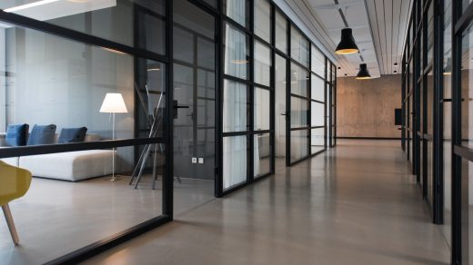 business office space hallway between glass-panel doors