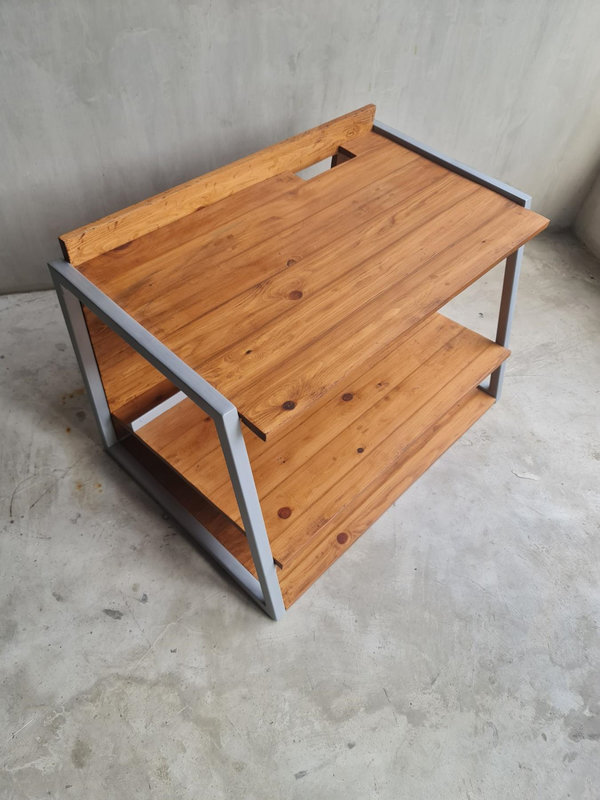 Wooden pallets donated by FedEx Express Philippines were used by Trademark Kawpeng Designs to develop this custom media console.