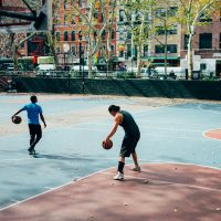 Basketball passing drills man in black shirt and black pants playing basketball during daytime