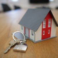 Search for Property white and red wooden house miniature on brown table