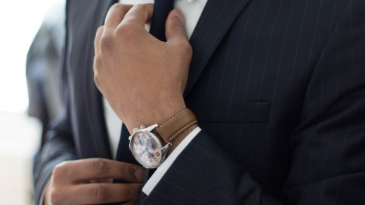 hiring an economist man wearing watch with black suit