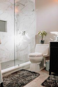 clogged toilet white ceramic toilet bowl beside white ceramic toilet bowl