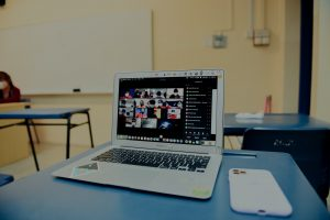 E-learning Videos macbook pro on blue table
