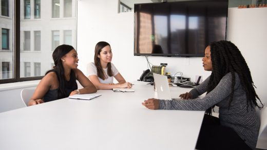 Managing Human Resources three women sitting at the table
