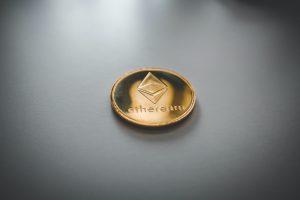 ethereum gold and black round emblem