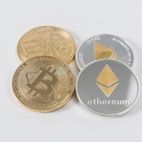 bitcoin ethereum four round silver-colored and gold-colored Bitcoins