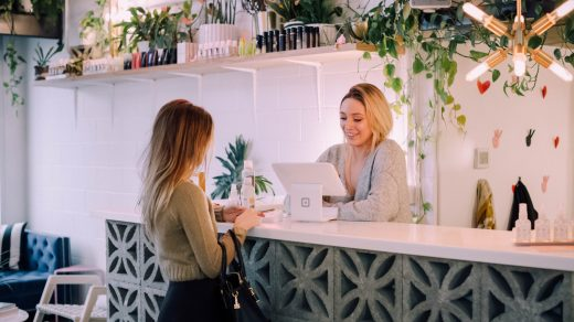 Make Your Business More Accessible woman facing on white counter