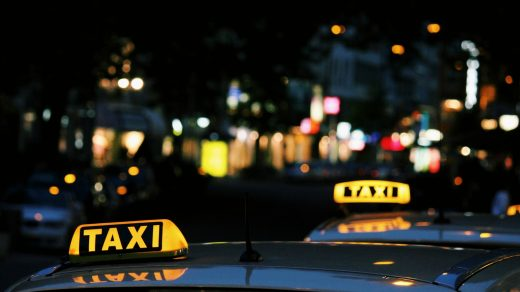 Taxi Booking App shallow focus photography of Taxi signage