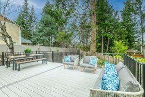 Deck Repair white wooden bench on wooden deck