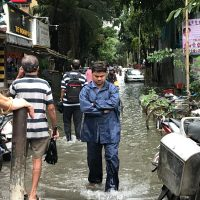 Disaster Preparedness people walking on flooded streets during day