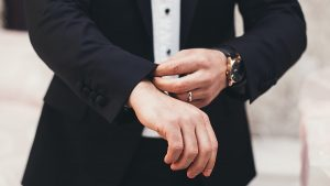 Guide for Entrepreneurs A man's hands adjusting the cuffs of his black suit