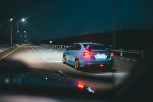 auto insurance white sedan on road during night time