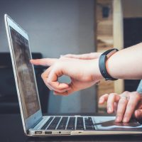 Online Directories person using laptop