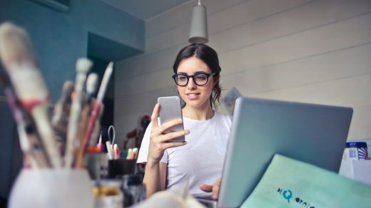 CRM woman in white shirt using smartphone